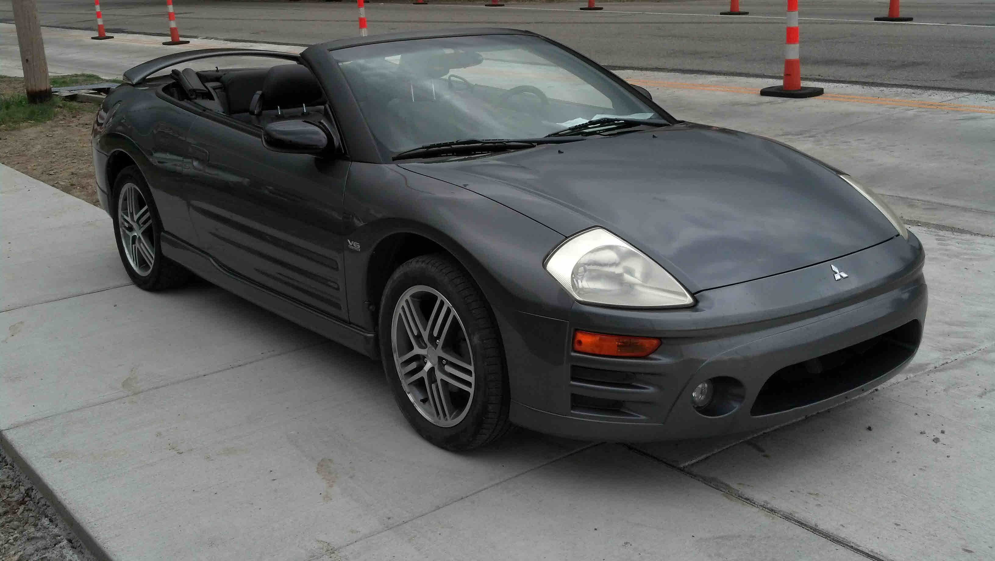 Silver, dark grey leather interior, V-6 3.0 liter, 5 speed ...