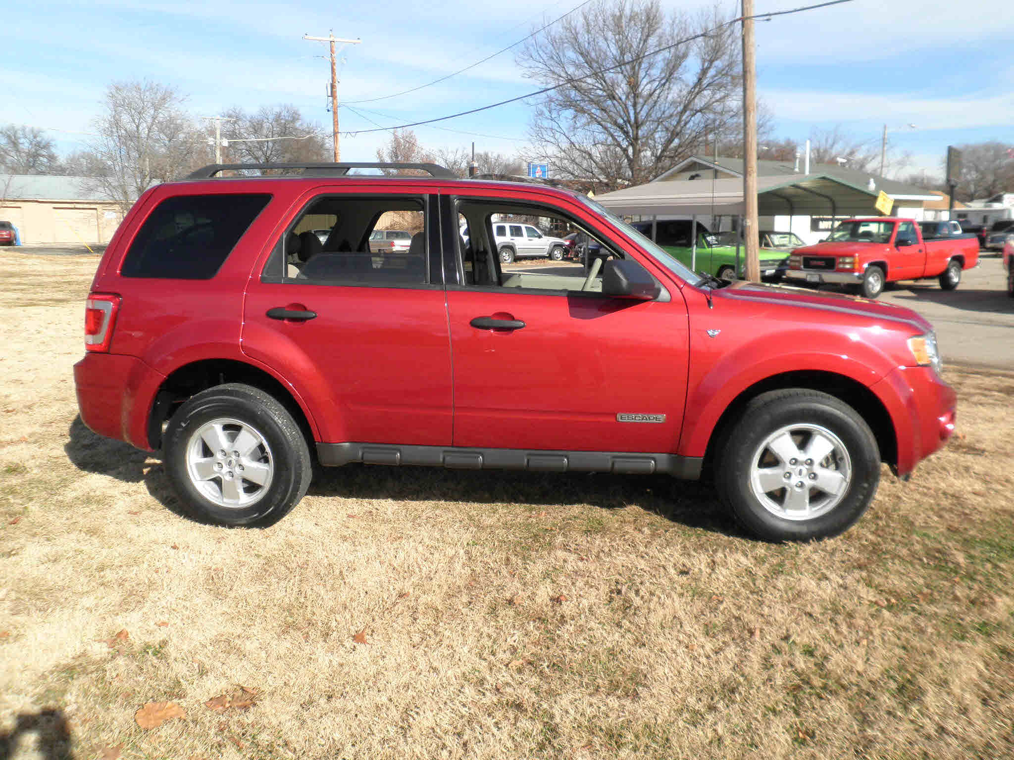 4 Wheel Drive >> Bright maroon, sand colored interior, auto, front-wheel drive, 4 door, keyless entry, a/c ...