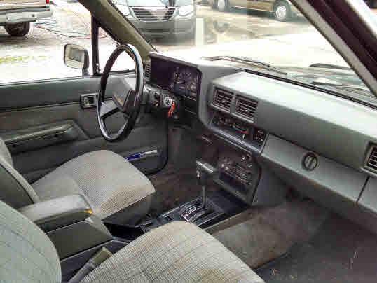 black light grey cloth interior 4 cylinder auto one owner 2 door a c cruise tilt am fm