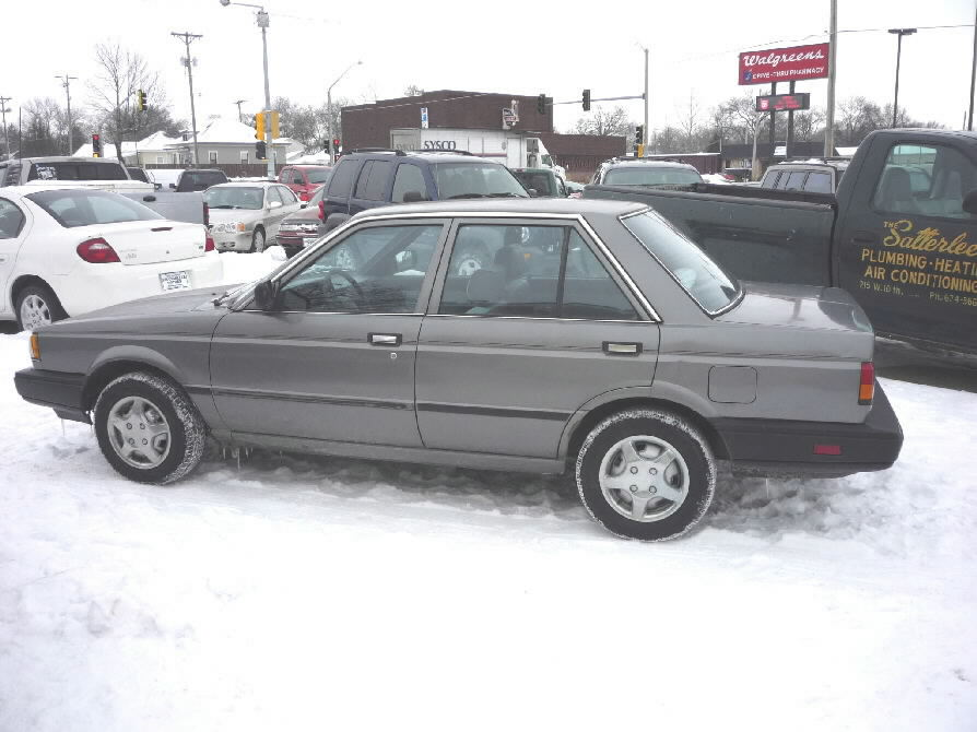 Grey, grey cloth interior, 4 cylinder, 5 speed, 4 door, am ...